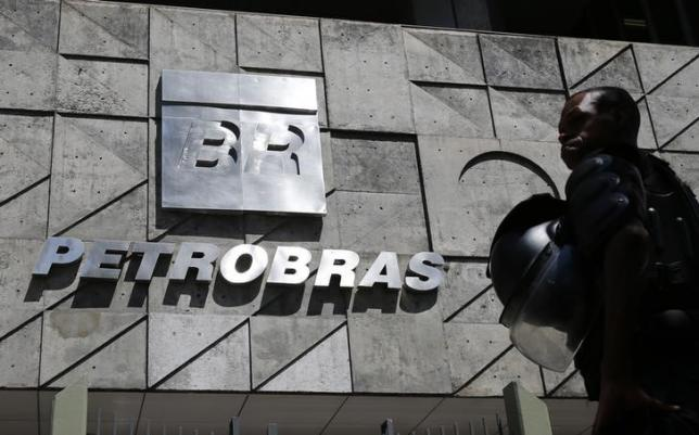 A policeman stands in front of the Petrobras headquarters during a protest in Rio de Janeiro